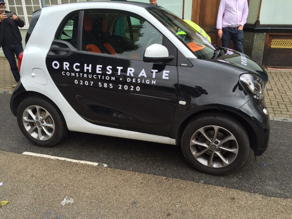 Orchestrate Company with white stickers on the Smart doors