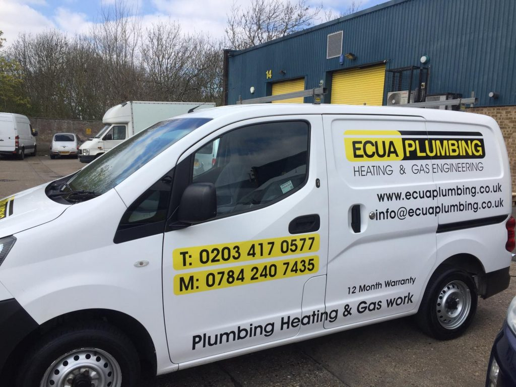 Ecua Plumbing Heating - yellow and black stickers applied on sides
