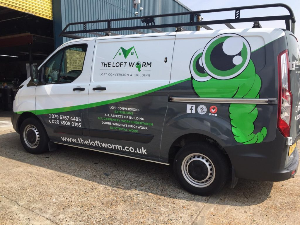 The loft Worm with Green Worm and grey wrap material on half of the van