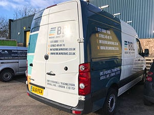 Half Van Wrapping blue vinyl done it in Leyton business centre