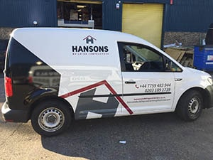 Hansons construction Half Wrapping Van with black and grey vinyl