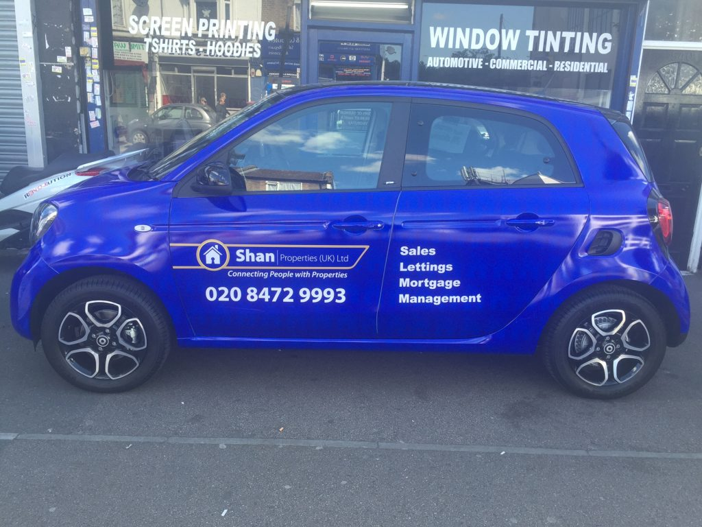 Full Car Wrapping - Blue Printed Vinyl with houses on background