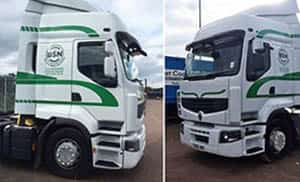 Green Stickers on White Trucks - Truck Graphics Services